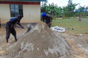 The Water Project: Jivuye Primary School -  Mixing Cement To Sand