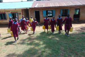 The Water Project: Jivuye Primary School -  Pupils Helping By Bringing Water