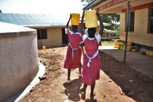 The Water Project: Jivuye Primary School -  Children Carrying Water