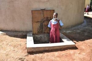The Water Project: Jivuye Primary School -  Children Drinking Water