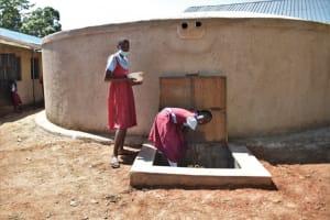 The Water Project: Jivuye Primary School -  Children Fetching Water