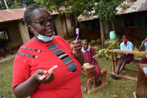 The Water Project: Jivuye Primary School -  Facilitator Demonstrating Dental Hygiene