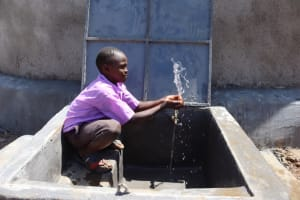 The Water Project: Bahati ADC Primary School -  Pupil Splashing Water