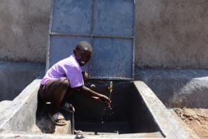 The Water Project: Bahati ADC Primary School -  Pupil Washing Hands
