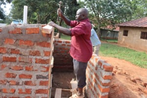 The Water Project: Itabalia Primary School -  Artsan Laying Roofing Frames