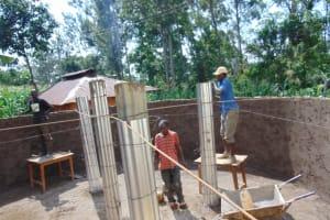 The Water Project: Itabalia Primary School -  Artsans Setting Pillars