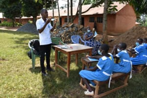 The Water Project: Itabalia Primary School -  Facilitator Demonstrates Mask