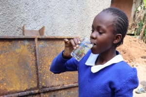 The Water Project: Itabalia Primary School -  Pupil Quencing Her Thirst