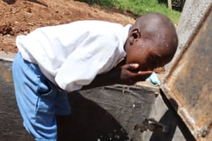 The Water Project: Itabalia Primary School -  Pupil Washing His Face