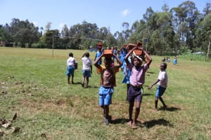 The Water Project: Itabalia Primary School -  Pupils Carrying Bricks