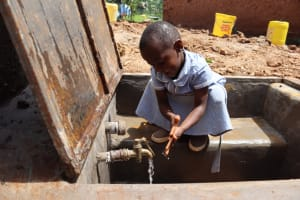 The Water Project: Itabalia Primary School -  Purity Washing Her Hands