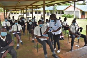 The Water Project: Salvation Army Matioli Secondary School -  Distributing Materials To Participants