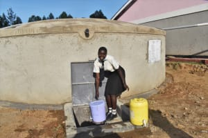 The Water Project: Salvation Army Matioli Secondary School -  Girl Collecting