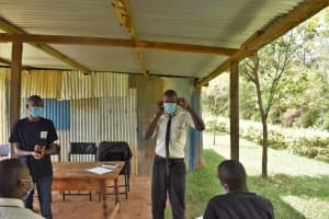 The Water Project: Salvation Army Matioli Secondary School -  Student Demonstrates Mask Wearing