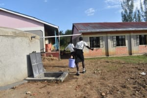 The Water Project: Salvation Army Matioli Secondary School -  Carrying Fetched Water