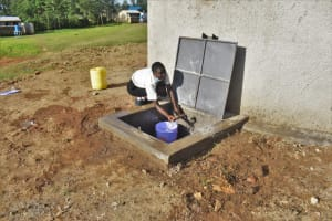 The Water Project: Salvation Army Matioli Secondary School -  Fetching Water From Tank