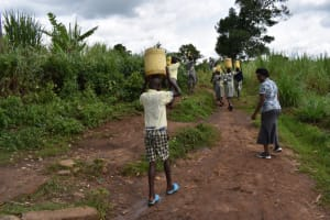 The Water Project: Friends Ikoli Primary School -  Students Carrying Water