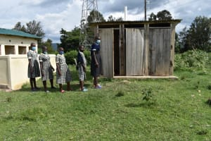 The Water Project: Friends Ikoli Primary School -  Students Line Up At The Latrine