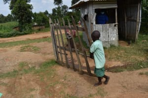 The Water Project: Mutoto Primary School -  Pupil Opening The School Gate