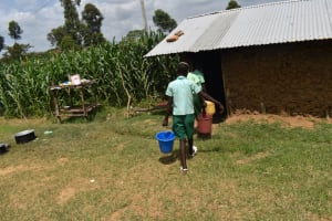 The Water Project: Mutoto Primary School -  Pupils Carrying Water To The Kitchen