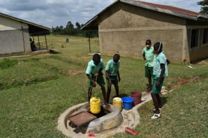The Water Project: Mutoto Primary School -  Pupils Fetching Water From Well