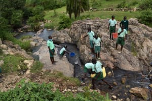 The Water Project: Mutoto Primary School -  Pupils Fetching Water