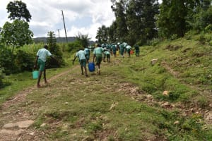 The Water Project: Mutoto Primary School -  Carrying Water To School