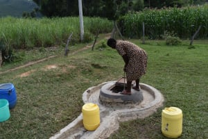 The Water Project: Mutoto Primary School -  Fetching Water From Dug Well