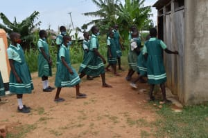 The Water Project: Mutoto Primary School -  Girls Line Up To Use The Pit Latrines