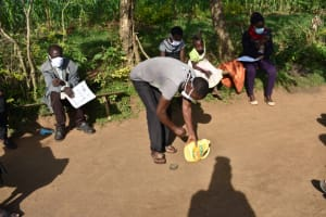 The Water Project: Eshimuli Community, Mbayi Spring -  Community Member Makes Handwashing Tin
