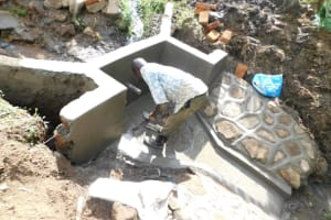 The Water Project: Eshimuli Community, Mbayi Spring -  Construction Of Floor