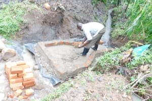 The Water Project: Eshimuli Community, Mbayi Spring -  Construction Of Walls