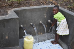 The Water Project: Eshimuli Community, Mbayi Spring -  Dorine Washing Hands At The Water Point