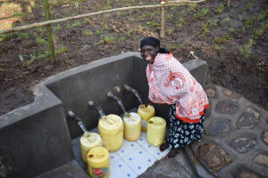 The Water Project: Eshimuli Community, Mbayi Spring -  Four Pipes Four Containers At Once