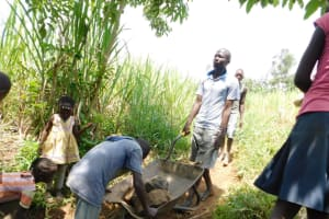 The Water Project: Eshimuli Community, Mbayi Spring -  Layer Of Large Rocks