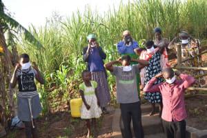 The Water Project: Eshimuli Community, Mbayi Spring -  Masking Up