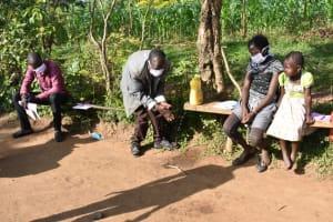 The Water Project: Eshimuli Community, Mbayi Spring -  Mr Mbayi Washing Hands