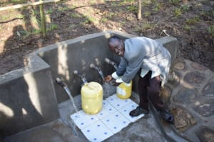 The Water Project: Eshimuli Community, Mbayi Spring -  Mr Mbayi Handicapped Easily Accesses Water