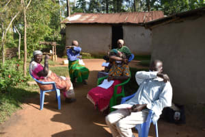 The Water Project: Eshimuli Community, Mbayi Spring -  Participants Cough Using Bent Elbow
