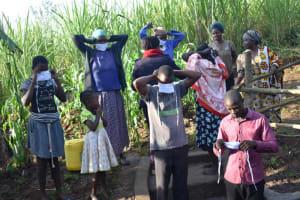 The Water Project: Eshimuli Community, Mbayi Spring -  Participants Masking Up