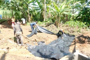The Water Project: Eshimuli Community, Mbayi Spring -  Placing Of Plastic