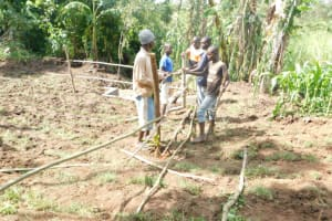 The Water Project: Eshimuli Community, Mbayi Spring -  Setting Up Of Protective Fence