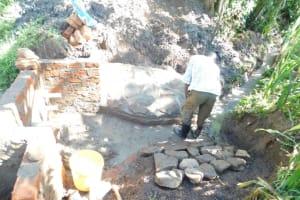 The Water Project: Eshimuli Community, Mbayi Spring -  Stone Pitching