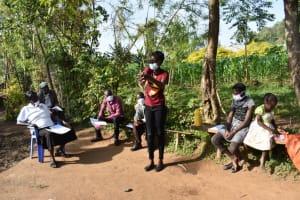 The Water Project: Eshimuli Community, Mbayi Spring -  Trainer Shares Handwashing Steps