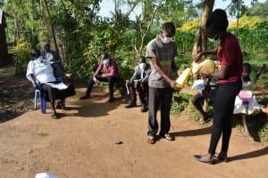 The Water Project: Eshimuli Community, Mbayi Spring -  Water Into Handwashing Tin