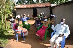 The Water Project: Eshimuli Community, Mbayi Spring -  Waving