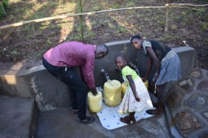 The Water Project: Eshimuli Community, Mbayi Spring -  Young And Old Can Fetch Water
