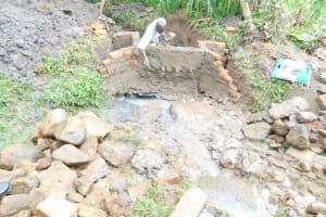 The Water Project: Eshimuli Community, Mbayi Spring -  Plastering