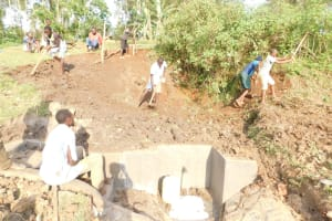 The Water Project: Mukhuyu Community, Namukuru Spring -  Back Filling With Soil