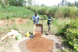 The Water Project: Mukhuyu Community, Namukuru Spring -  Community Members Preparing Materials